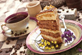 Cake with tea and gift box — Stock Photo