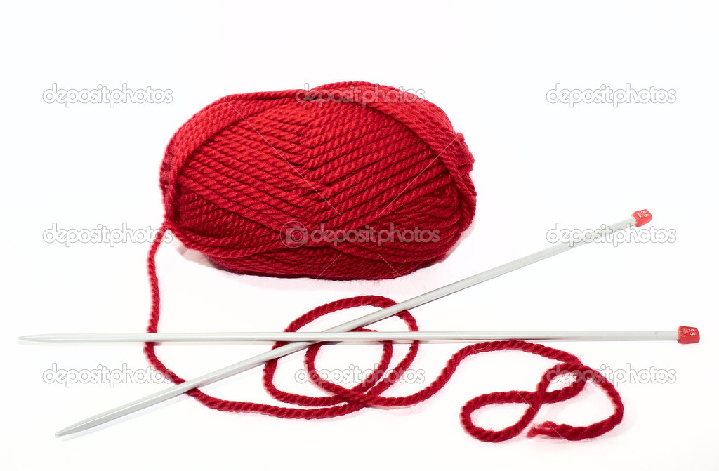 Red yarn with knitting needles on a white backgr — Stock Photo #2266095