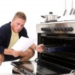 Young man clueless in kitchen — Stock Photo