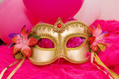 Golden mask with flowers — Stock Photo