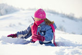 Happy child play at winter snow — Stock Photo
