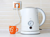 Jug kettle water drink warmer and cup — Stock Photo
