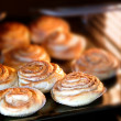 Cinnamon rolls baking — Stock Photo