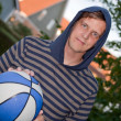 Cool young man with basketball — Stock Photo