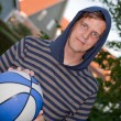 Cool young man with basketball — Stock Photo #2442395
