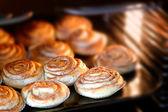 Cinnamon rolls baking — Stock Photo