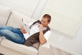 Man relaxing on the couch — Stock Photo