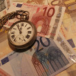 Clock and money — Stockfoto