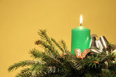 Green candle greeting card ikebana — Stock Photo