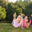 Sisters lying in the park — Stock Photo