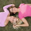 Sisters relax in the grass — Stock Photo #2456356