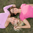 Sisters relax in the grass — Stock Photo