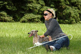 Blind woman with her litte dog — Stock Photo