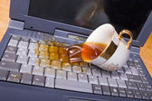 Coffee spilling on keyboard — Stock Photo