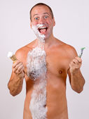 Unshaved man with foam — Stock Photo