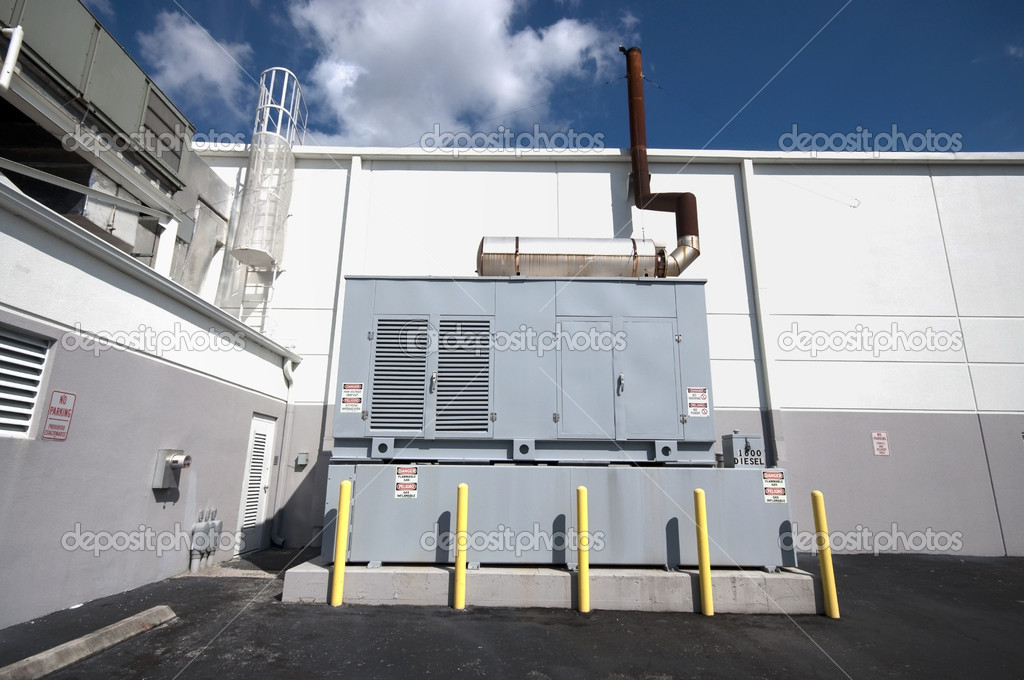 Diesel backup generator on the outside of an industial building, automatic start up when power goes out. — Stock Photo #2284180