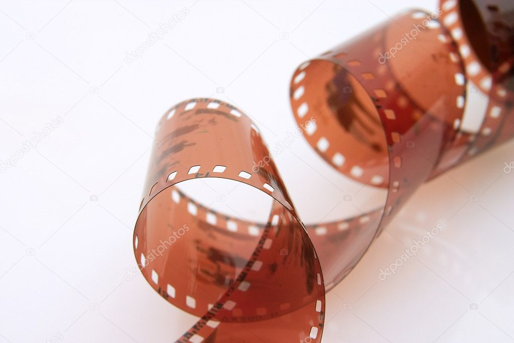 Expose 35 mm film wave over white background — Stock Photo #2481469