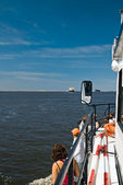 Tourists at the travel boat — Стоковое фото