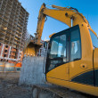 Excavator at the construction place — Stock Photo