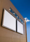 Two blank ads on abstract building — Stock Photo