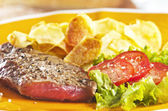 Steak and chips — Stock Photo