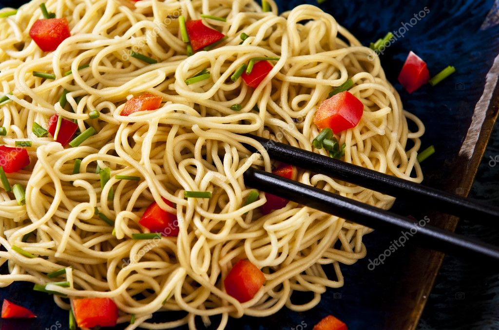 Chinese noodles with vegetables served on a blue dish  Stock Photo #2338169