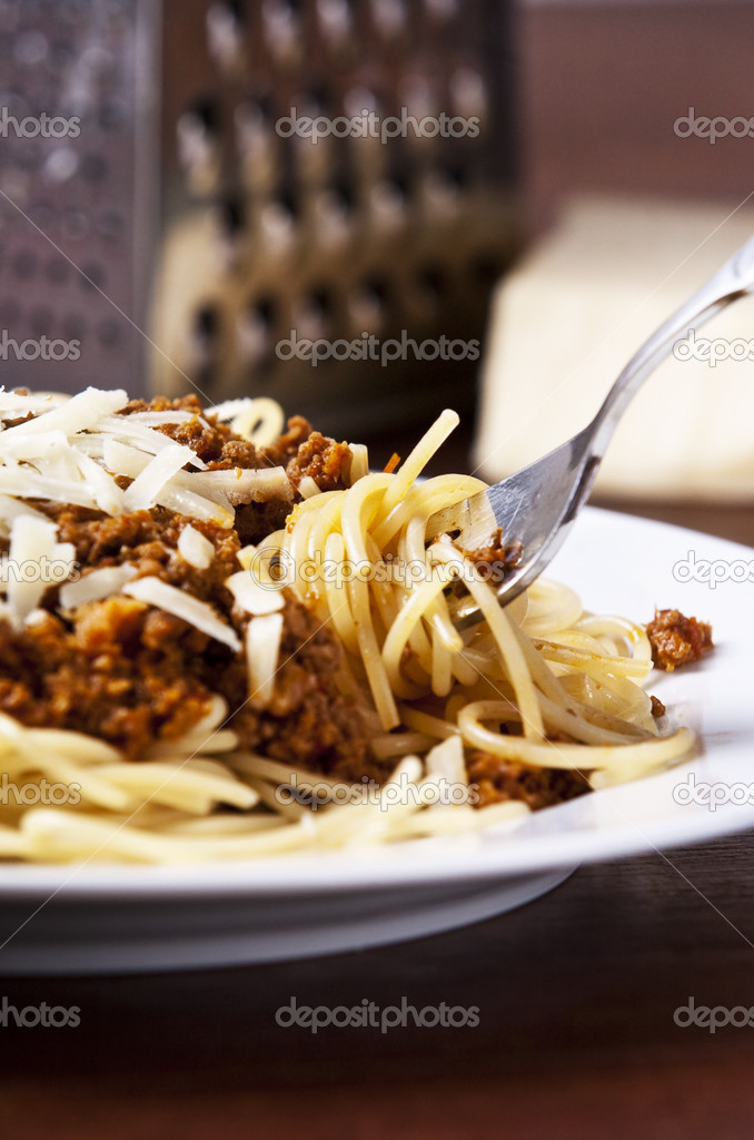 Spaghetti bolognese served on white plate — Stock Photo #2338218