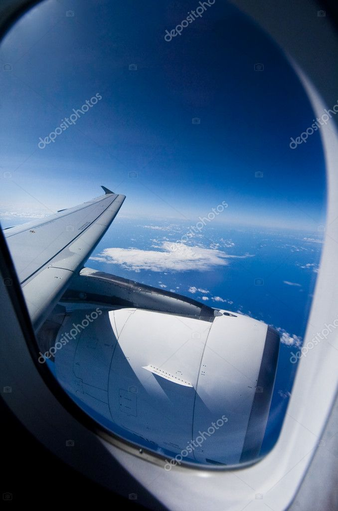Looking out the window of a plane  — Stock Photo #2338251