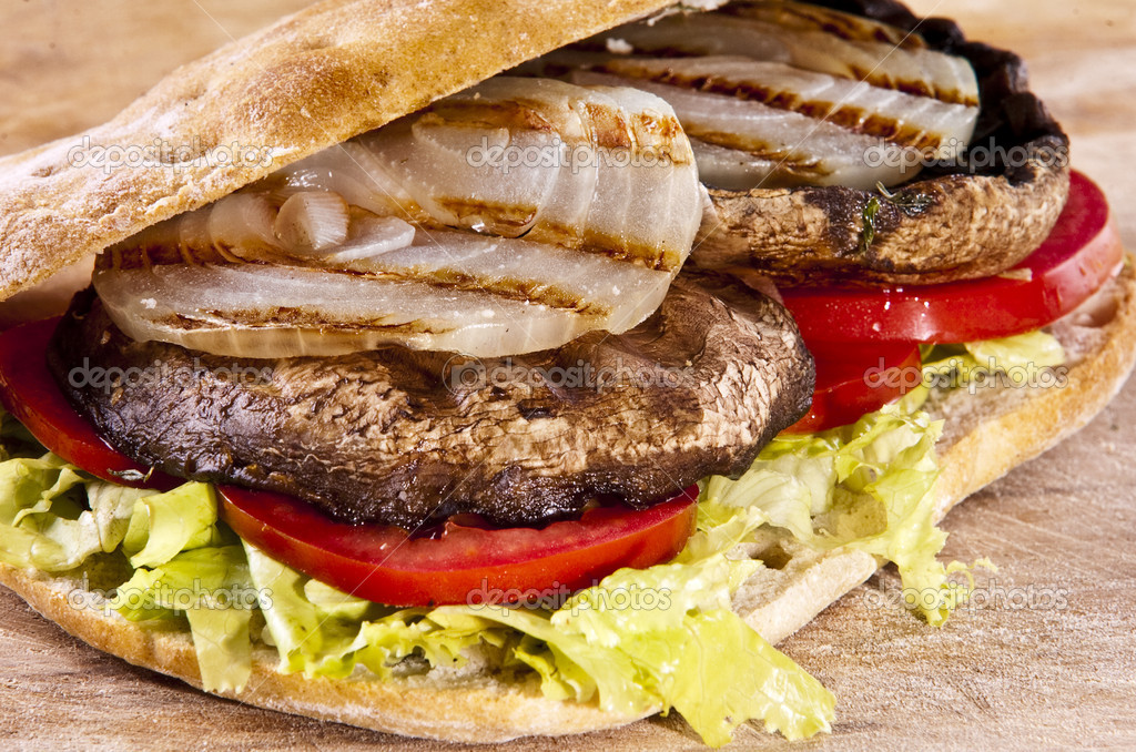 Portobello sandwich with grilled onion lettuce and tomato — Stock Photo #2338288