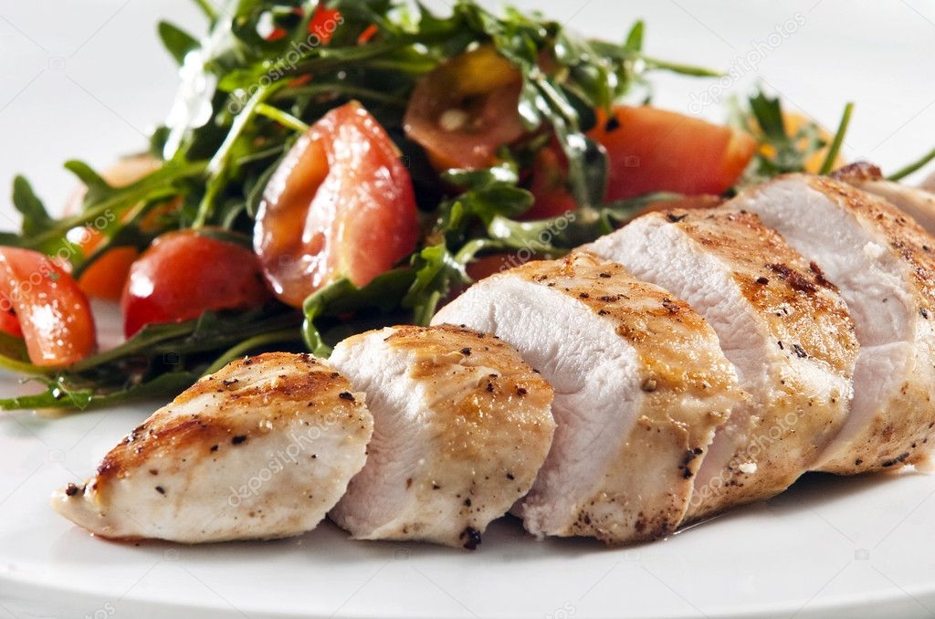 Grilled chicken breast served with salad — Stock Photo #2339656