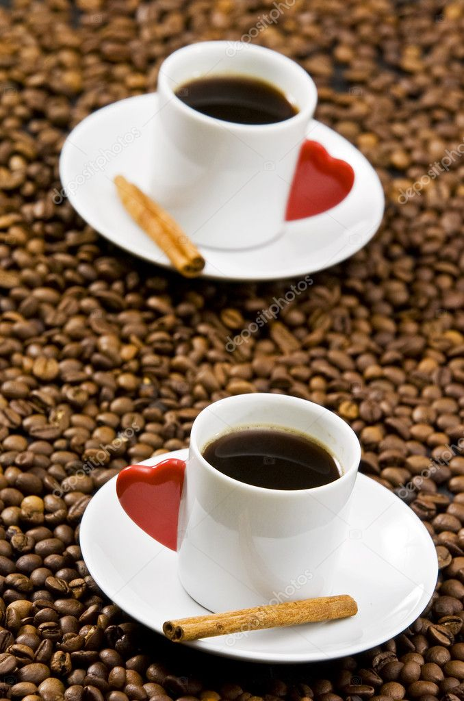 Espresso served on heart shaped cup on coffee beans — Stock Photo #2339854