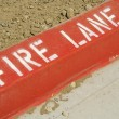 Foto Stock: Red Fire Lane Curb