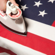 Stockfoto: Ironing Out Wrinkles in U.S. Flag