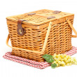 Picnic Basket, Grapes and Folded Blanket - Stock Photo