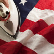 Ironing Out the Wrinkles in U.S. Flag - Stock Photo
