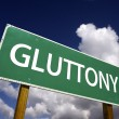 Gluttony Green Road Sign — Stockfoto