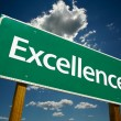 Stock Photo: Excellence Road Sign Over Sky and Clouds