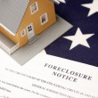 Foreclosure Notice and House on Flag - Stock Photo