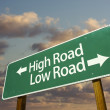 High and Low Road Green Road Sign - Stock Photo