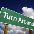 图库照片: Turn Around Road Sign