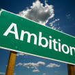 Foto de Stock  : Ambition Green Road Sign Over Sky