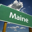 Foto de Stock  : Maine Green Road Sign On Sky and Clouds