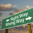 Right and Wrong Way Green Road Sign - Stock Photo