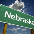 Nebraska Green Road Sign - Stock Photo