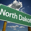 North Dakota Road Sign - Stock Photo