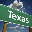 Texas Road Sign Over Sky and Clouds - Stok fotoğraf