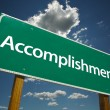 Stock Photo: Accomplishment Green Road Sign