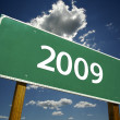 2009 Road Sign with dramatic clouds — Stockfoto