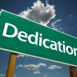 Dedication Green Road Sign - Stock Photo