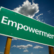 Empowerment Green Road Sign Over Clouds - Stock Photo